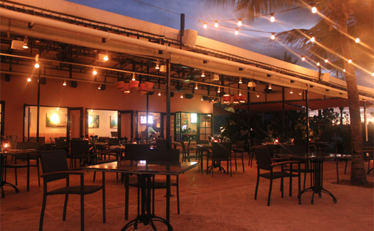 Straw Hat Restaurant at night.