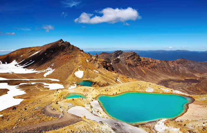 Emerald Lakes, Tongariro National Park in New Zealand is a scenic hiking trail.